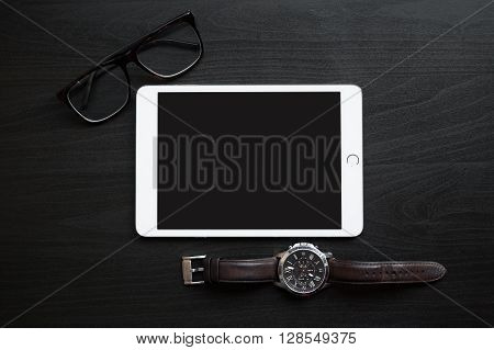 Tablet Computer Is On A Table With Glasses And Watches