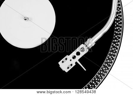 Turntable Needle On A White Plate