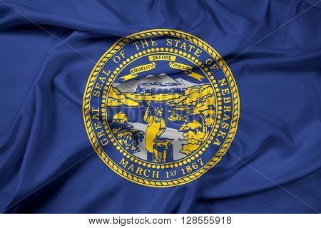 Waving Flag of Nebraska State, with beautiful satin background.