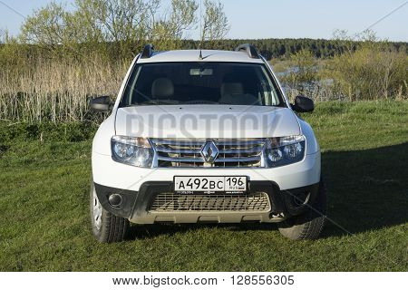 Nizhnyaya Ilenka, Russia - May 02, 2016: White Renault Duster car on a green lawn