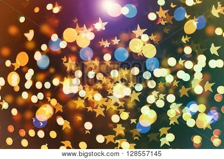 abstract texture, light bokeh background. Colorful gold circles amd starts of light