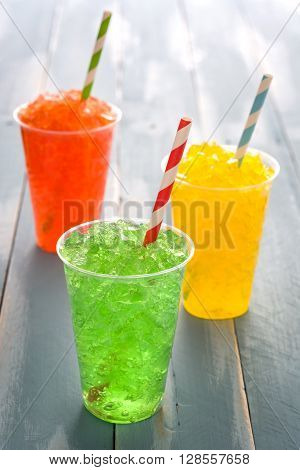 Colorful summer fresh drinks on blue wood