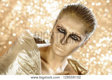 Portrait of a beauty model in creative makeup with heavy eyes