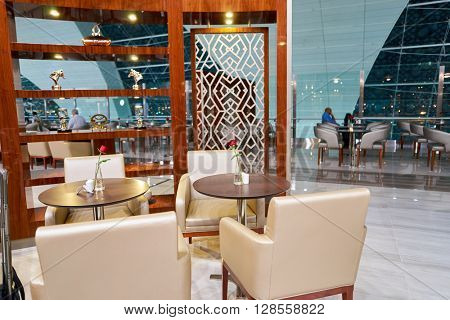 DUBAI, UAE - APRIL 09, 2016: interior of Emirates Business Lounge. Emirates is an airline based in Dubai, United Arab Emirates. It is the largest airline in the Middle East