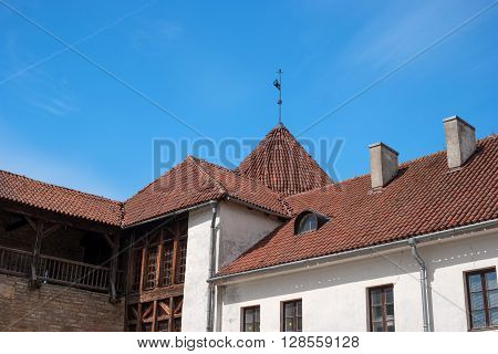 Narva Estonia - Herman Castle. Tile roofs of buildings around the castle. Close-up. On the left side - Bohemia Gallery ramparts.