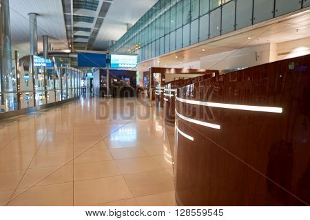DUBAI, UAE - APRIL 09, 2016: inside of Dubai International Airport. Dubai International Airport is the primary airport serving Dubai, United Arab Emirates