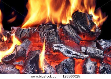 Flaming Charcoal Isolated On Black Background