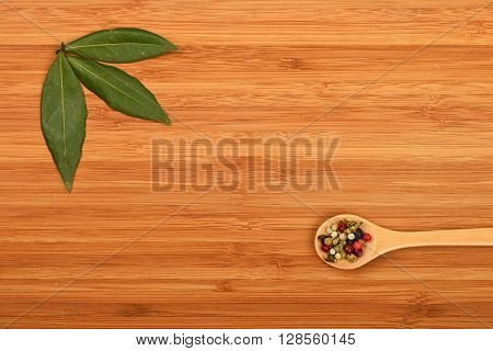Bay Leaves And Peppercorn On Wood
