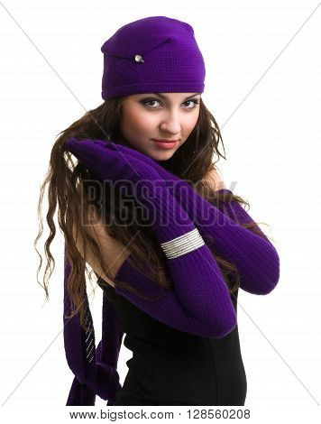knitwear. young woman wearing a winter cap and gloves isolated on white background