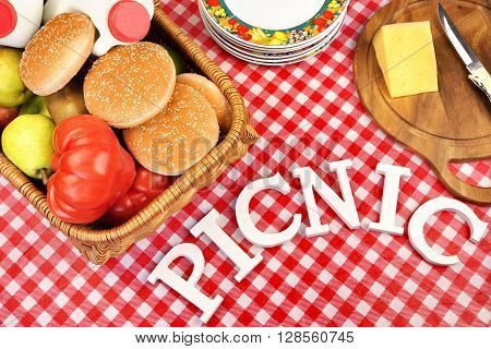 Sign Picnic On Table With Lunch In Basket, Top View