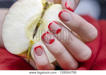 Woman's hand with red french manicure. Close up photo.