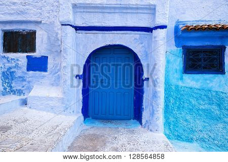 Detail of a door and windows in the town of Chefchaouen in Morocco