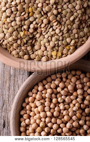 Two Clay Bowls Full Of Chickpeas And Lentils