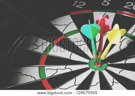 Light Focused On A Three Darts On Bulls Eye, Retro Style