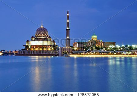 Putra mosque and Malaysia federal building during blue hour.