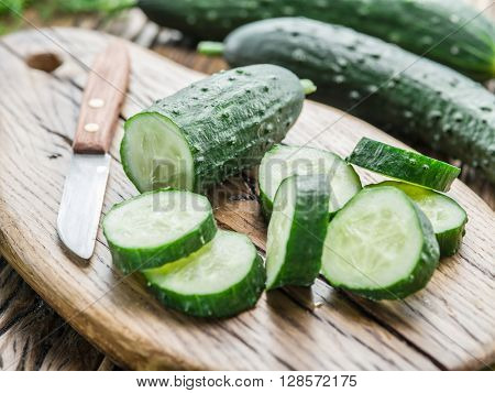 Cucumbers on the wooden table.