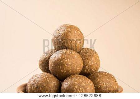 The indian sesame sweet or tilgul laddu, made up of jaggery and sesame seeds, hand made, round, indian sweet prepared in Makar Sankranti festival