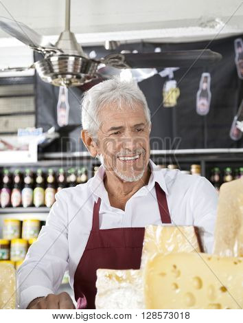 Happy Salesman In Cheese Shop
