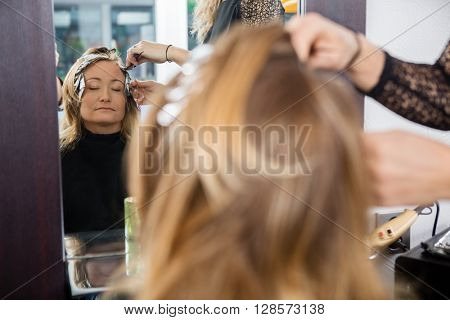 Woman Having Hair Dyed At Beauty Parlor