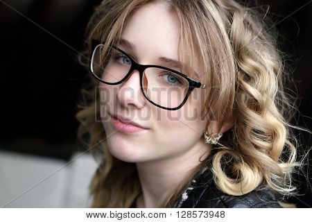 Smiling Teen In Glasses