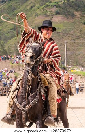 Banos Ecuador - 30 November 2014: Portrait Of A Young Hispanic Cowboy Throwing A Lasso South America Competition In Banos On November 30 2014