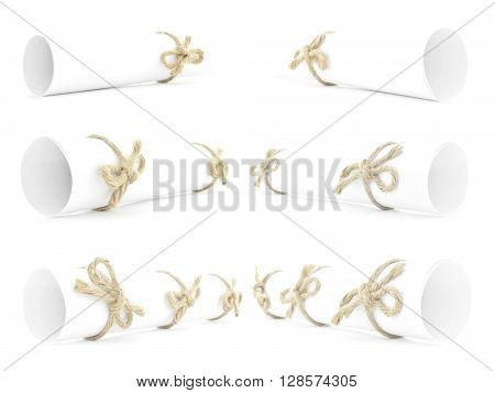 White paper scrolls tied with natural ropes and bows isolated