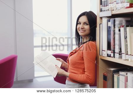 Education, study. Woman in library