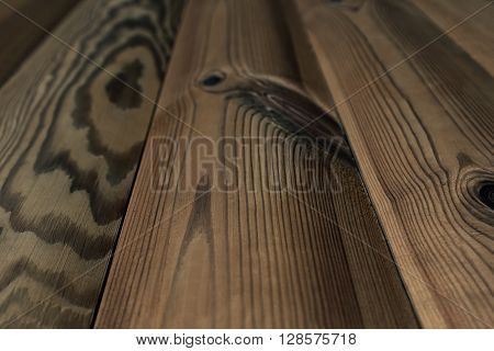 The aged brown planks. The wood texture. The background. The diagonal plank.