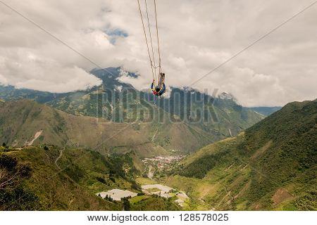 Unidentified Man Swinging On A Swing Called Flight Of The Condor Banos De Agua Santa Ecuador