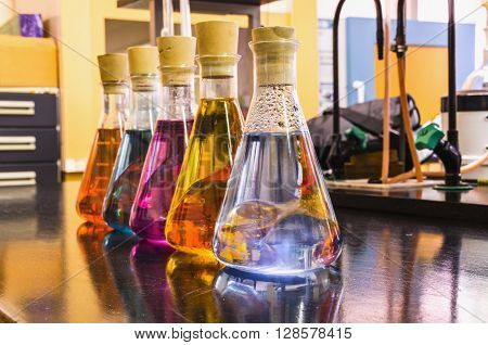 Chemical liquids in glass bottles. Chemistry investigation and research.
