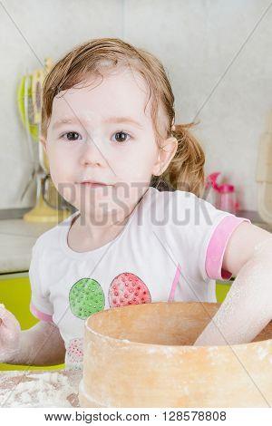 Little Girl Sifts Flour