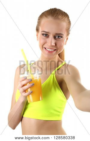 Young woman making selfie photo with plastic cup of orange juice isolated on white