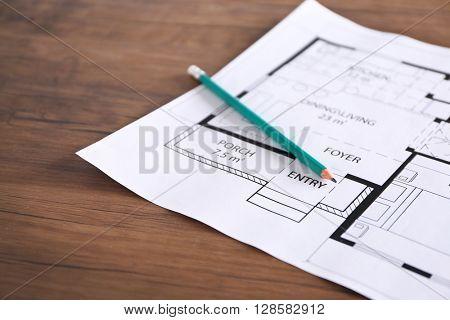 Construction drawings with pencil on wooden table closeup