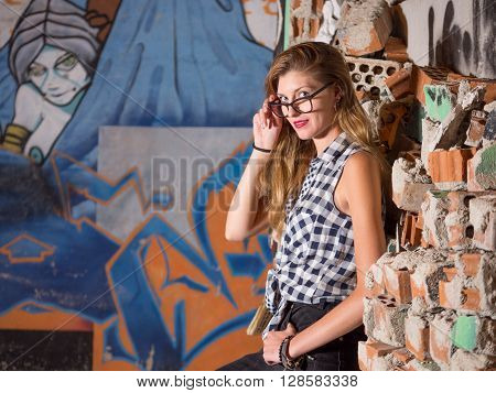 portrait blond woman with glasses looking at camera