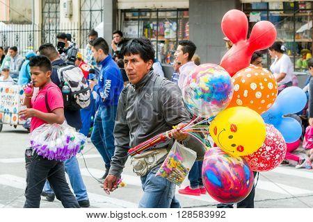 Banos De Agua Santa - 29 November 2014: Balloon Seller On The Streets Of South America In Banos De Agua Santa On November 29 2014