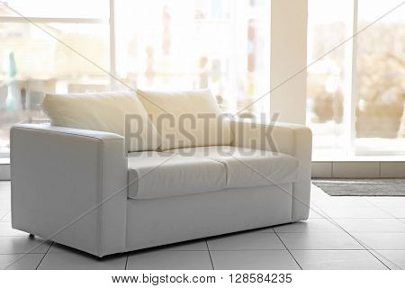 White sofa in a room.