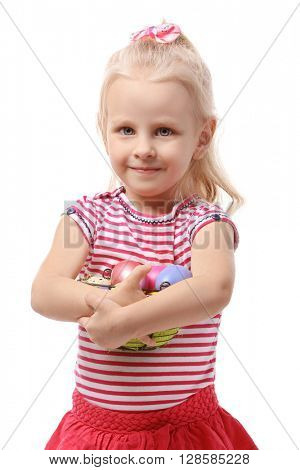 Little girl holding basket with Easter eggs isolated on white