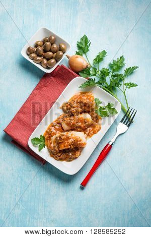 cod fillet with  olives and  tomatoes sauce