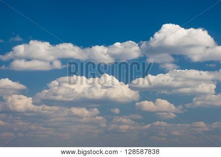 many of Cumulus clouds against the blue sky background