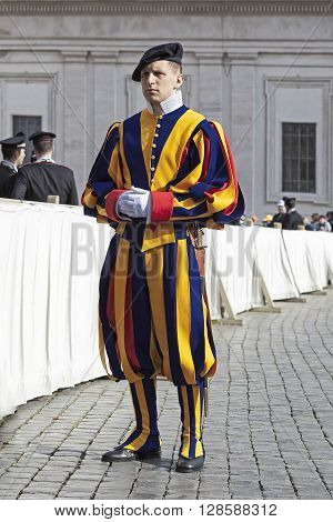 Rome Italy - April 30 2016: Swiss Guards with their colorful uniform feature lined up in St. Peter's Square in the general audience of the Pope.