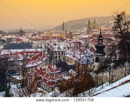 Houses and towers of Lesser town in Prague in winter time evening, Prague, Czech Republic