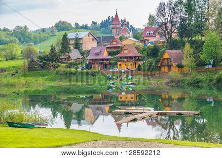 ZAWOZ, POLAND, MAY 2, 2016: small village on Solina lake shore (Bieszczady mountains,), in the beginning of May