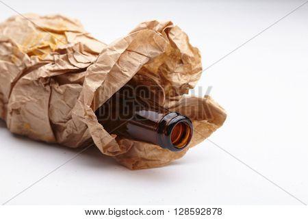 beer bottle in the paper bag