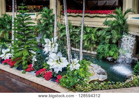 Honolulu, Hawaii, USA - Dec 15, 2015: Hyatt Regency Waikiki Beach Resort and Spa atrium, ground floor. This area is open to the public and is often busy with people walking around the different levels, both day and night.
