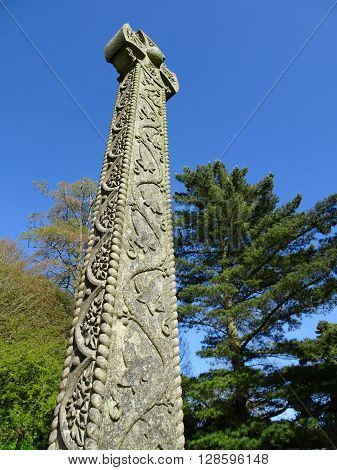 Ornately Carved Stone Cross And Forest Landscape Photographed At Killerton In Broadclyst In Devon