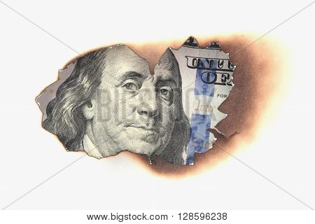 burning dollar bill as a symbol of inflation and the financial crisis