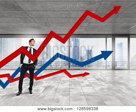 Business man in office with arrows upwards