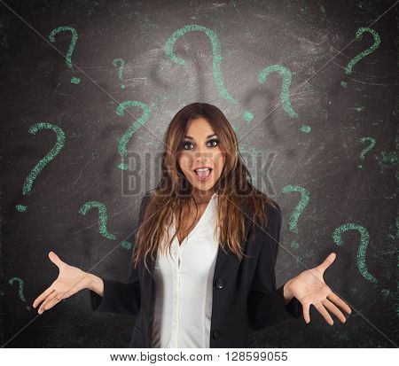 Confused businesswoman with green question marks background