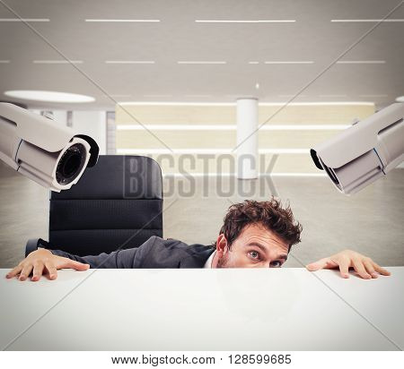 Cameras pointed at a businessman who hides