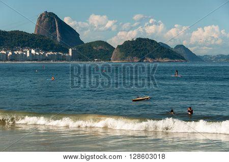 Copacabana Beach with Sugarloaf Mountain in the Horizon, Rio de Janeiro
